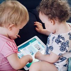 toddlers playing with tablet