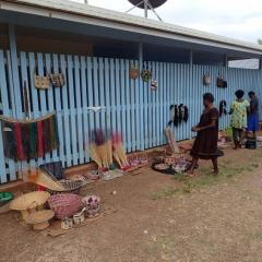 Visiting women from the South Fly selling their crafts