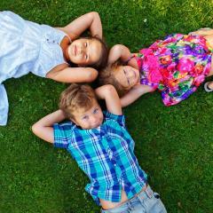 children lying in grass